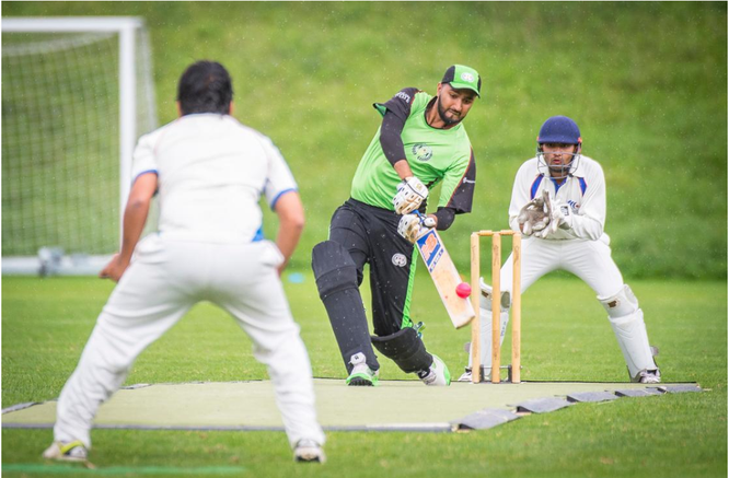 A batsman from St. Gallen Cricket Club defends the wooden wicket by knocking the ball away (the wicket keeper behind him). (Image: Urs Bucher)