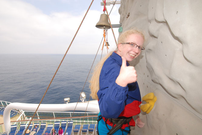 on top of the rock climbing wall onboard. The view was perfect!