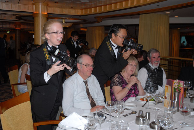 During formal night, shooting in a restaurant
