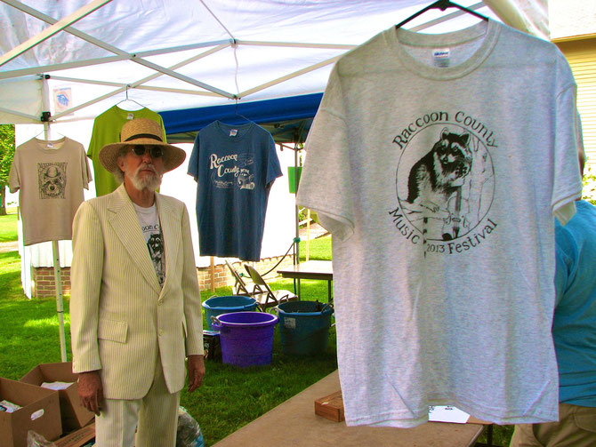 Tee Shirt Salesman -- Dr. Raccoon, Jim Wohlken  (2013 Shirt Artist was Tim Haas)