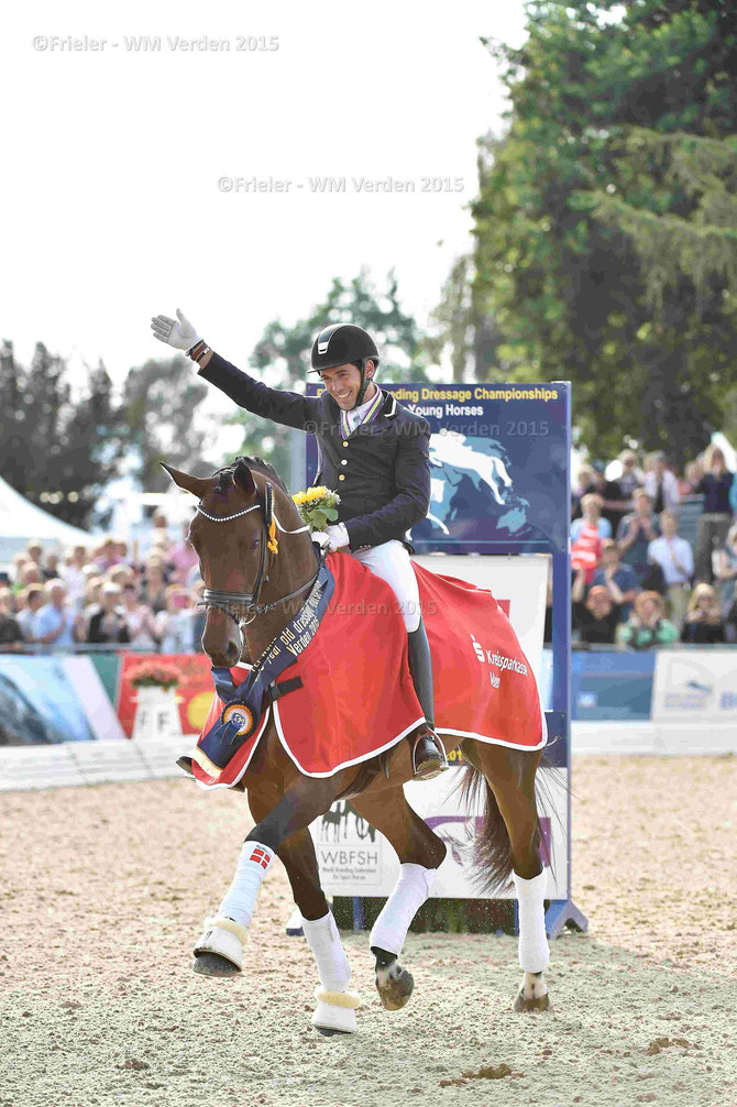 DWB-Mare Fiontini ist the new Worldchampion of five year-old Dressage-Horses. Her rider Severo Jesus Jurado Lopez celebrates that victory. (Photo by Karl-Heinz Frieler)