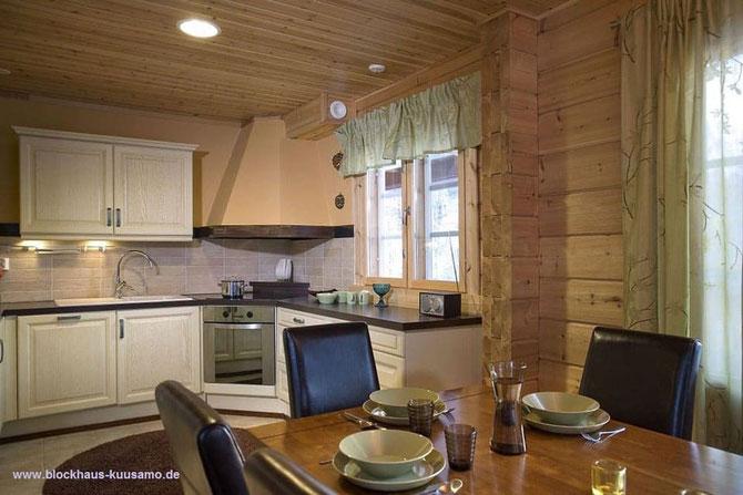 Wohnküche im Massivholzhaus  -  Nachhaltiges Holzhaus für ein perfektes Wohngefühl und Wohnklima  - finnische Holzhäuser für die Zukunft bauen-