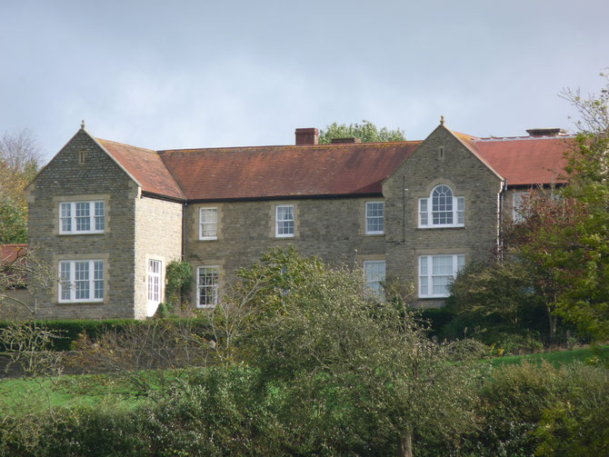 Farmhouse that has been extended with matching stone