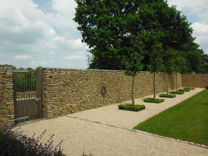 Walling stone creating a formal setting and space