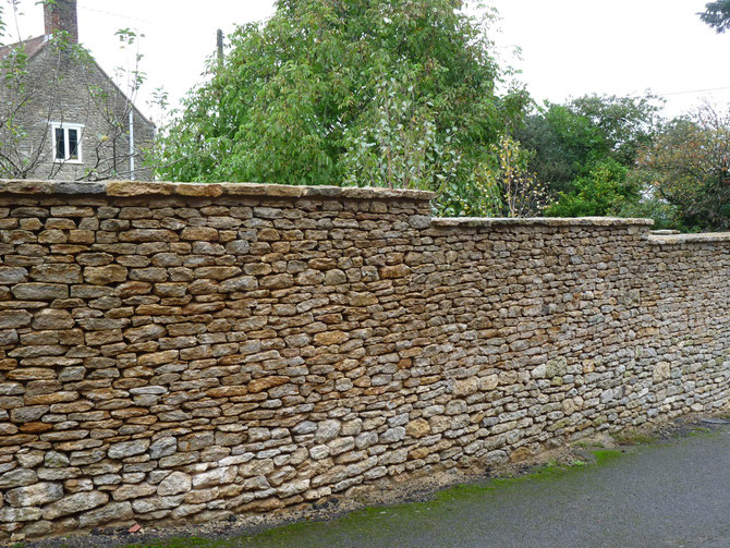 Wall sheltering the garden from the lane - adding value to the property