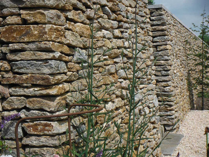 Dry stone wall - creating beauty and permanence - stability is from gravity with the tight joints