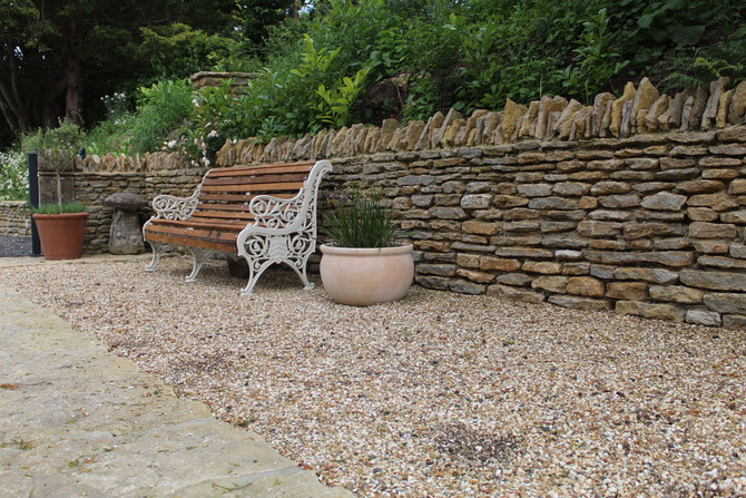 Retaining wall using dry stone walling - protecting the house from a road as well as creating more space
