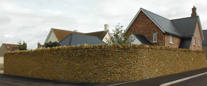 Drystone walling adding privacy as well as style and beauty to new housing