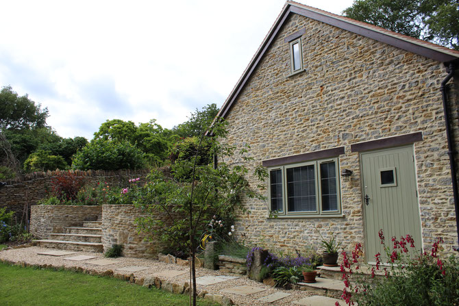 Different types of walling stone in the walls, paths and garden house
