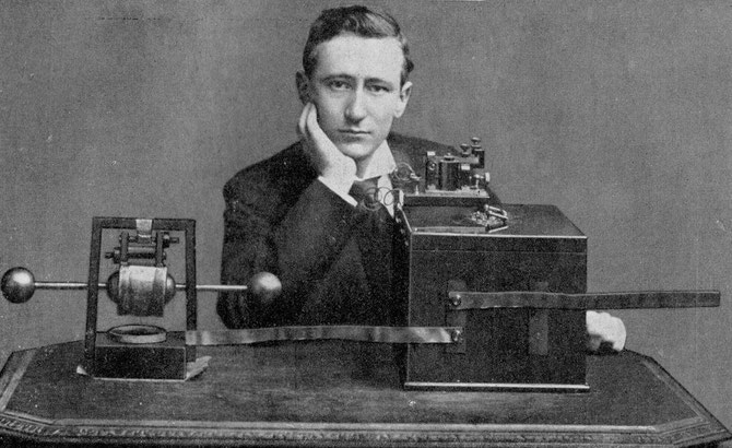 Marconi pictured in 1896 with an early Spark Gap transmitter and receiver that could send and receive Morse Code