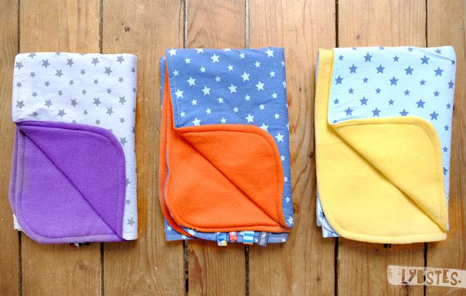 Babydecke bunte Sterne von Lybstes. für die Willkommenset-Aktion / Flüchtlingshilfe / Lila Orange Gelb