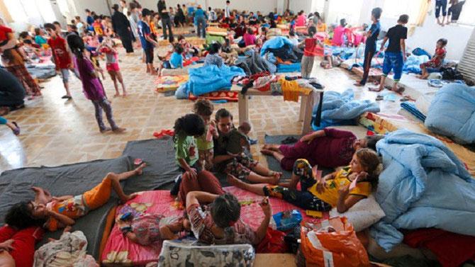 FIN JUIN 2014 : LA SURVIE DES CHRETIENS DE QARAQOSH.   C* KARIM SAHIB /AFP