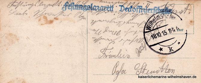 """Rückseite einer als Feldpost verschickte Ansichtskarte mit Feldpoststempel """"Festungslazarett Deckoffizierschule"""""""