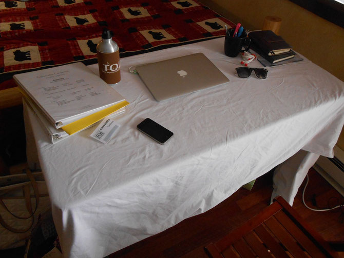 "There was a fold up table randomly in the room, so I took a sheet off the extra bed, made it a ""table cloth"" and set up my makeshift ""desk"" where I am typing this now."