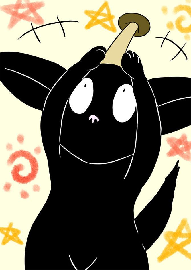 しめじを頭の上に掲げる黒猫