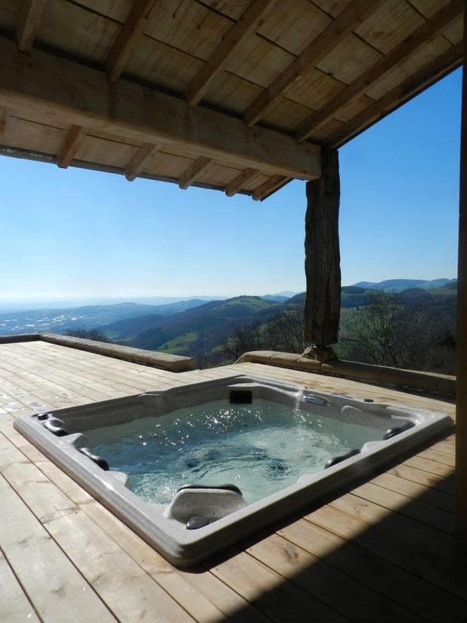 spa sauna jacuzzi mont du lyonnais vue magnifique lyon st etienne détente soins nature privatif