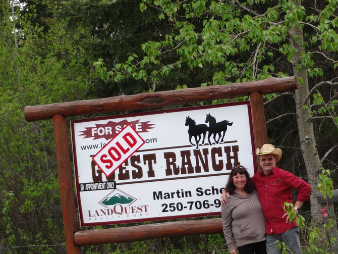 "Martin and Diana posing in front of the ""SOLD"" sign. Let the adventure begin!"