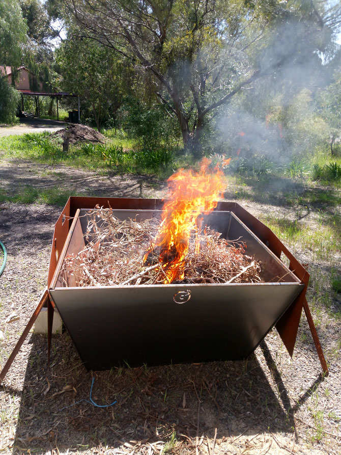 The Oregon Hybrid Kiln (OHK) inaugural burn with the original Flat-Tiki foldable heat shield