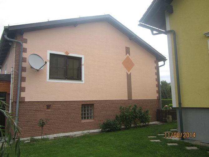 Fassade nachher (mit Schattenmalerei und Ornament)