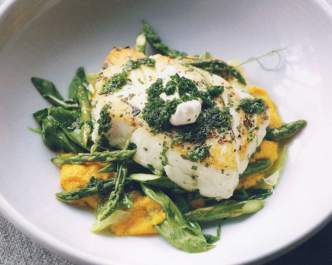 Alaskan Halibut on a bed of asparagus/vegetables and carrot purée, topped with creme fraice and pistou . . .