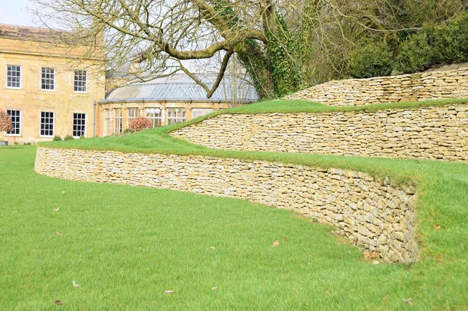 Terracing using drystone walling within a garden adding a structural work of art