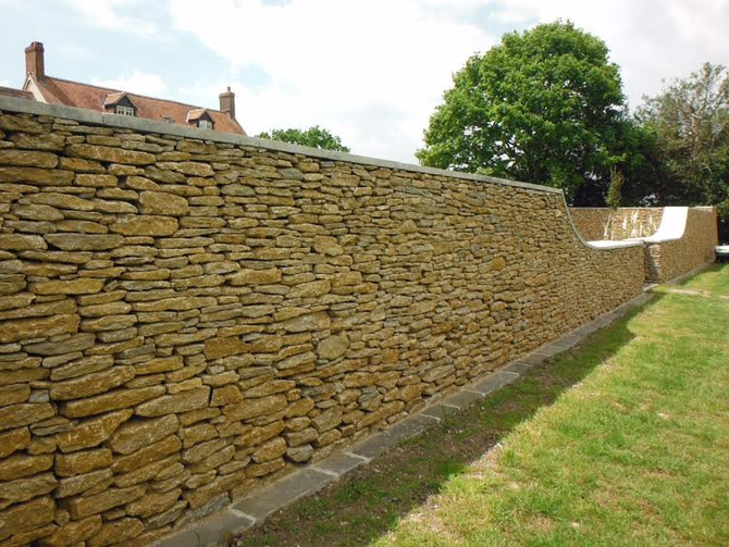Dry stone walling dividing the garden - this is more natural faced stone