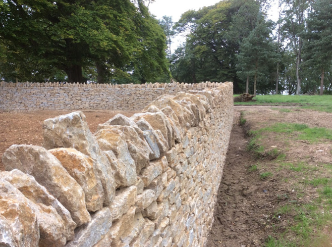 Wall with cock and hens - these add weight and stability to the wall, as well as framing the natural structure