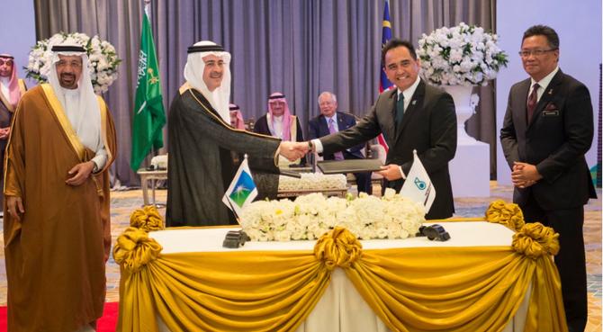 PT. & CEO ARAMCO AMIN AL NASSER et PT. & CEO PETROFINAS WAN SULKIFLEE WAN ARIFFIN .... Les négociations ont commencé à Genève et ont mis 3 années pour être concrétisées.