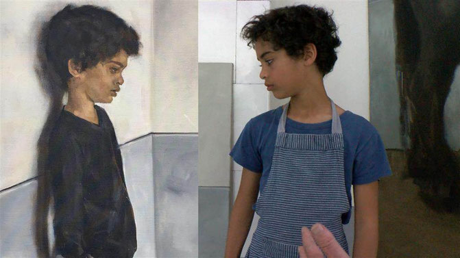 Boy looking at his own painted portrait