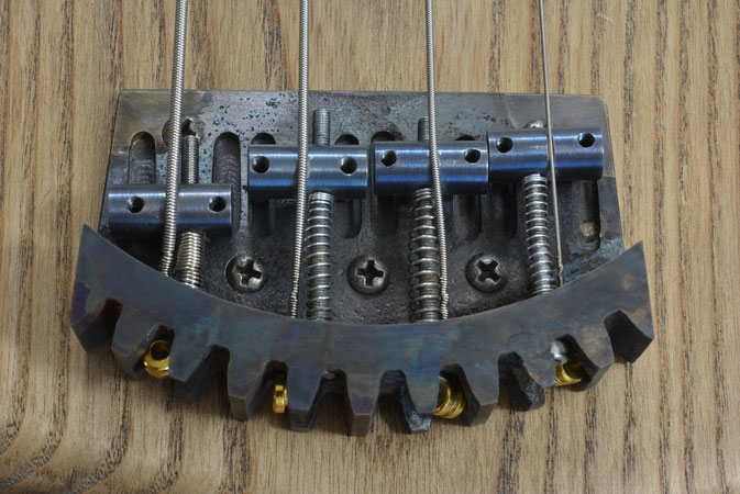 Bass guitar bridge built from a cog in (builds & work in progress) page