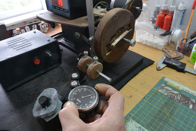SETTING THE WINDING  WITH A TENSION-O-METER  TO ENSURE A CORRECTLY TENSIONED COIL