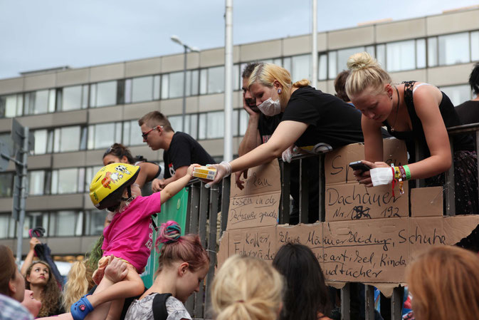 Volunteers collect food, water and clothes for refugees at Munich Main Station.