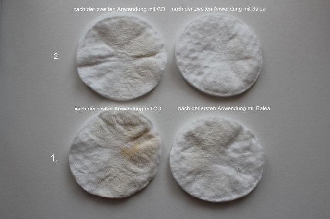 Bild : Rückstände nach der Anwenung vom CD Reinigungsschaum und Balea Reinigungsmousse auf einem Wattepad(Reinigungskraft)