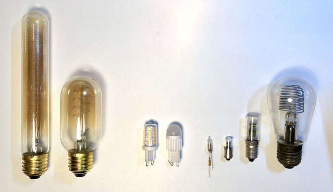 The picture shows 3 types of light bulbs: Edison incandescent bulbs, LED spot bulbs and neon glow bulbs