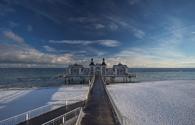 Historical seebruecke pier in Sellin on the island of Ruegen with snow, Baltic Sea, North East Germany, Europe