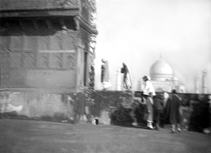MSI Collection ; 1937 - Baba and party tour the Red Fort in Agra, the Taj Mahal in the distance.