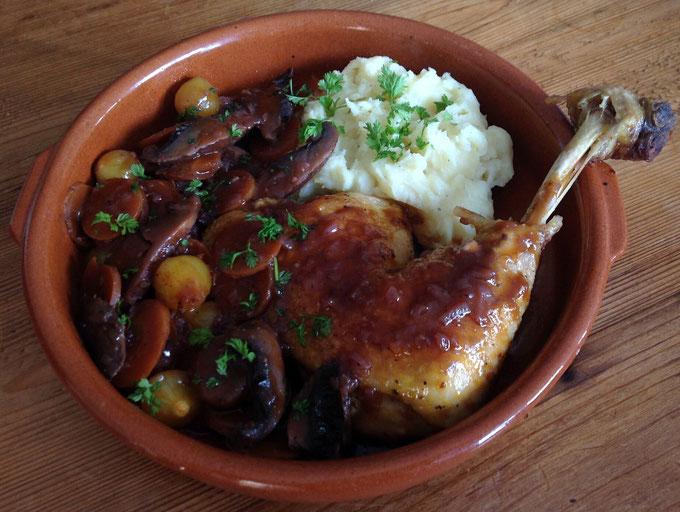 Coq au Vin met aardappelpuree.
