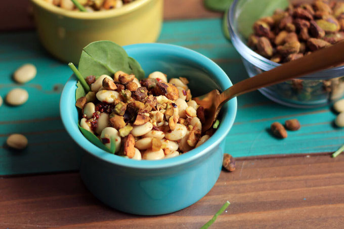 This Lupini Bean Salad with Crushed Pistachio is a delicious high-fiber side dish with a crunchy pistachio topping. It would make a great addition to any warm meal! #amyseatlist #beansalad #pistachios #italianbeansalad #highfiber