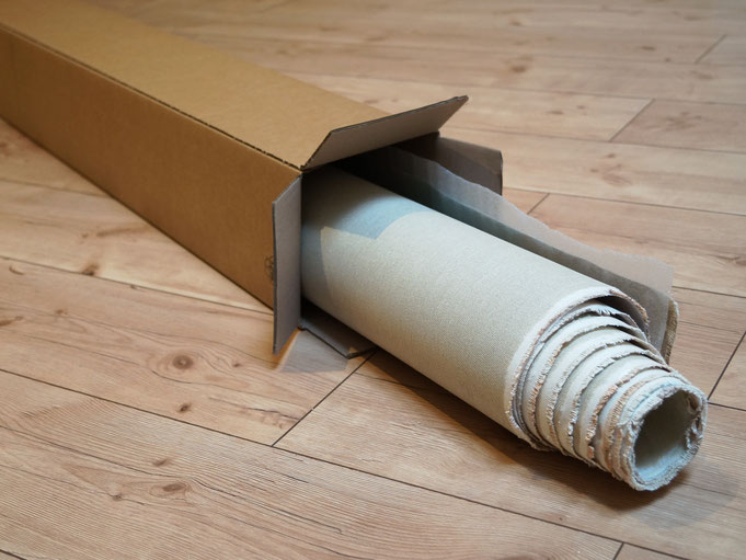 rolled canvas in a cardboard box