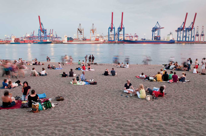 evening at elbe river beach background the terminals in the habour of Hamburg.© Christian Kaiser
