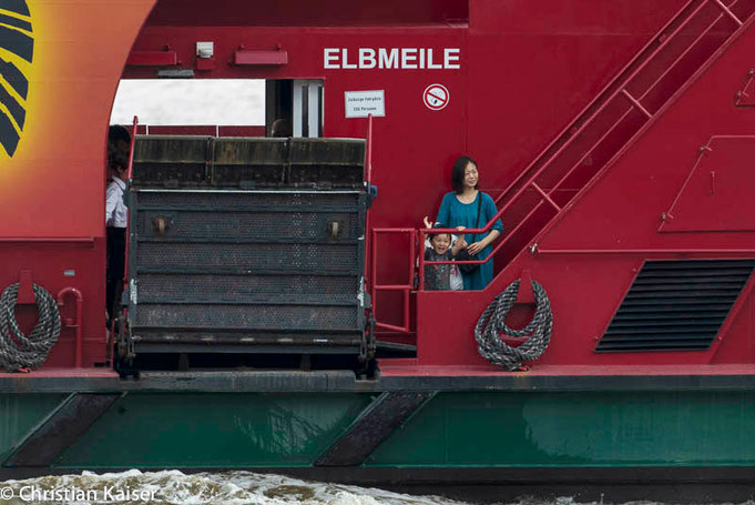 motther an child in the ferryboat ont the elbe river 62 towards Finkenwerder island. © Christian Kaiser