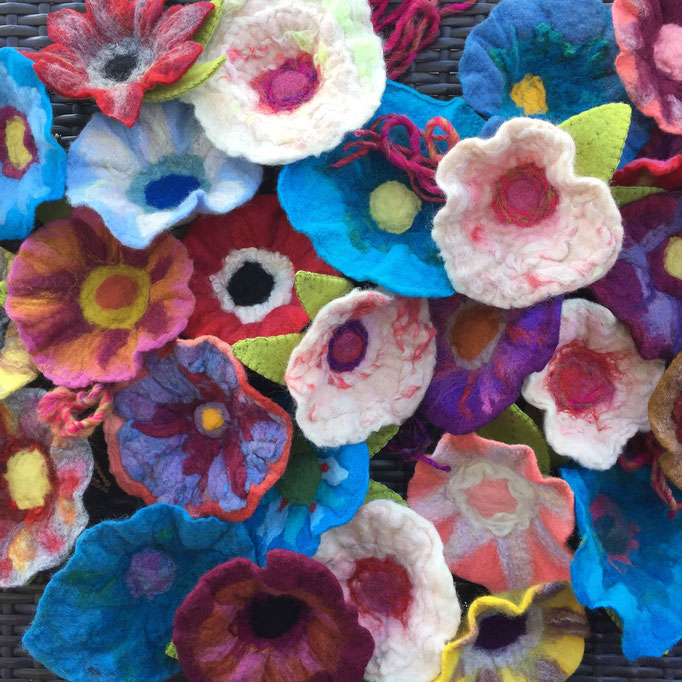 Wet felted flowers made from wool roving