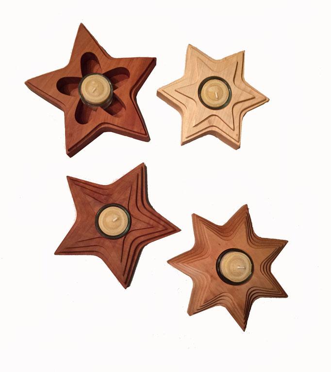 diverste Sterne mit Kerze