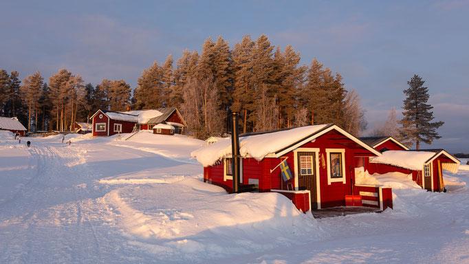 Lapplands Drag Huskyfarm in Lappland- die Blockhütten