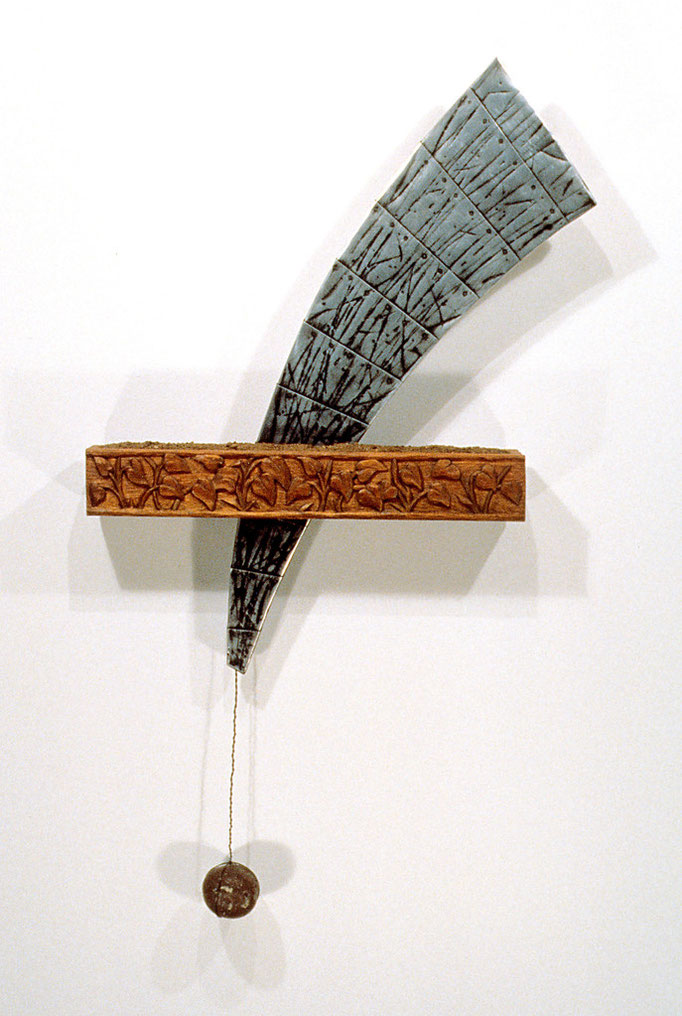 """The Power: 24 x 4 x 44"""" carved wood, metal flashing, rock, dirt"""
