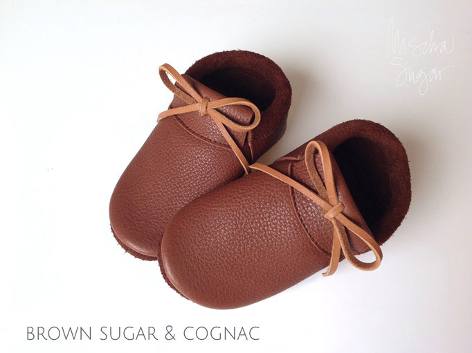 Mokassins in brown sugar mit Schleife in cognac, ab 40,90€