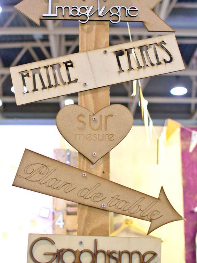 Flèches directionnelles en bois