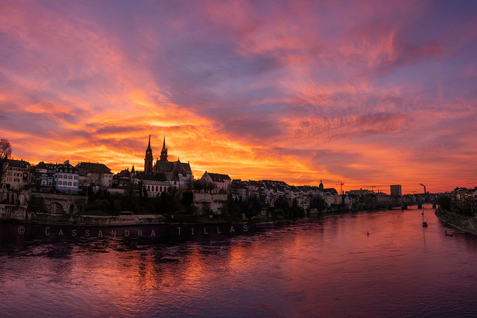The best place to watch the sunset in Basel is on the Wettsteinbrücke.