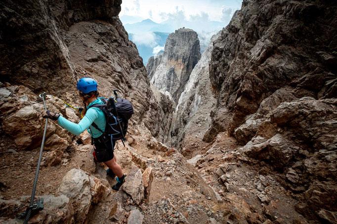 Via ferrata Bocchette Alte. Hiking along the ledges underneath Cima Brenta