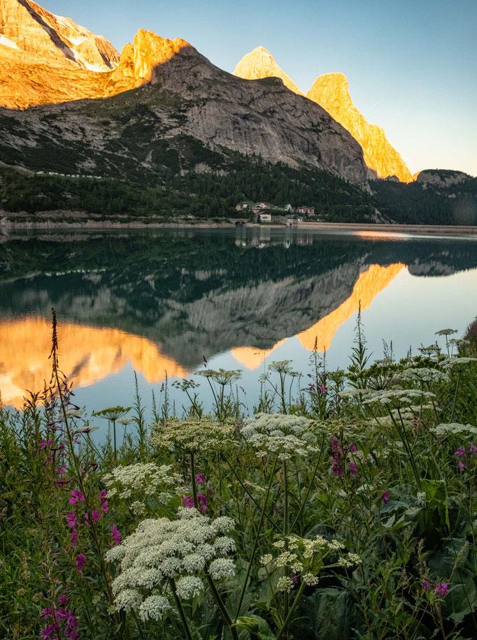 Marmolada reflecting in lake Fedaia.